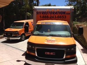 Water-Damage-Restoration-Truck-At-Residential-Job-Location