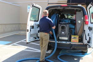 Water-Damage-Restoration-Van-And-Technician-At-Commerical-Job-Location-Sewage-Pipe
