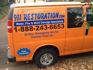 Water Damage Brookeville Restoration Van At Curbside Job Location