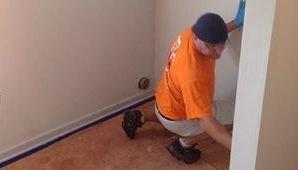 Water Damage Restoration Technician Doing Final Checks