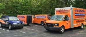 Water Damage Restoration Vehicles At Commercial Job Site