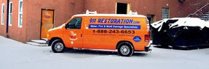 Storm Damage Restoration Van At Snowy Civic Job Site