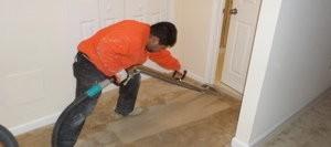 Water Damage Restoration Technician At Work